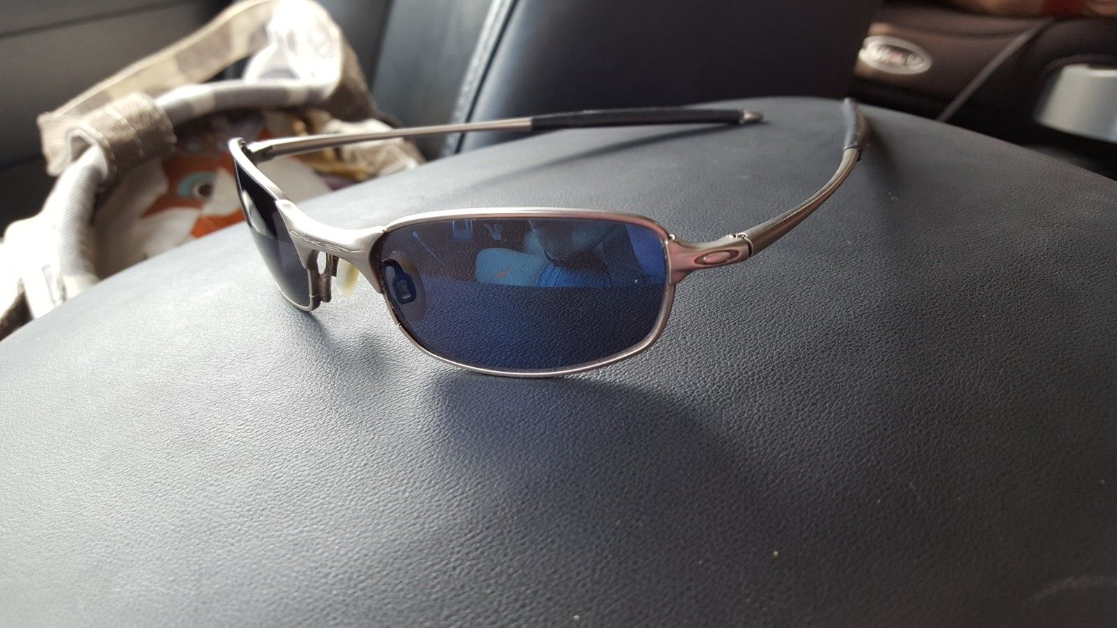 Old pair of Oakley Sunglasses - 1468862220132-516612237.jpg
