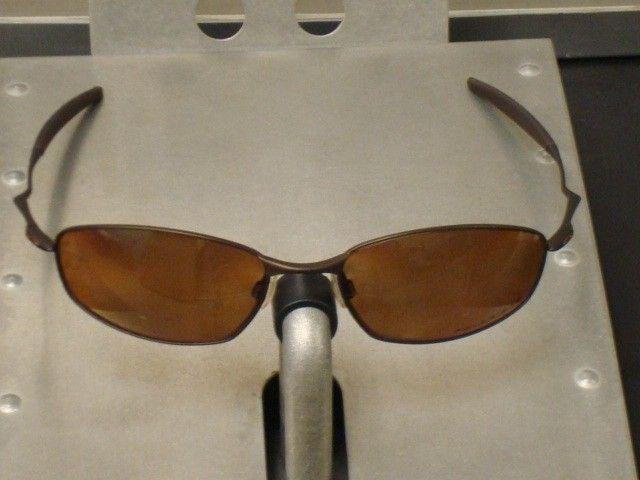 Oakley Whisker Brown / Bronze Polarized - DSC00077_zps230df25b.jpg