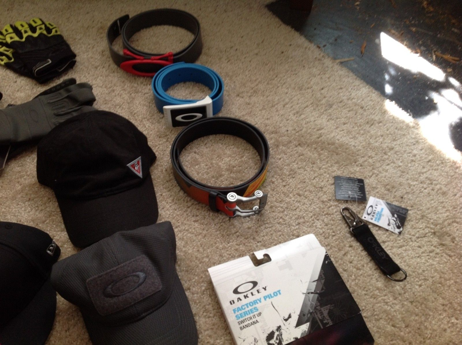 Collection of Oakley hats/ gloves/ belts/ wallets/ collectibles - image.jpeg