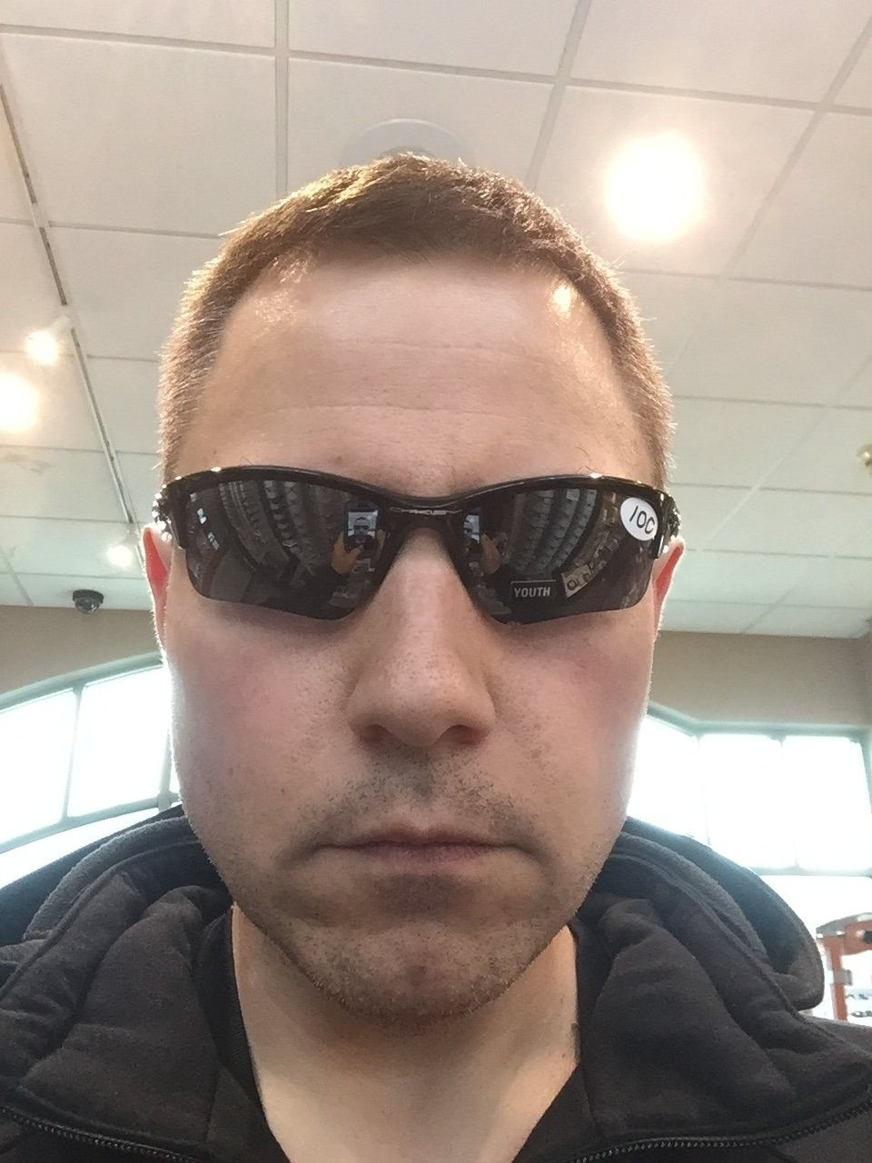 When you are bored waiting and start trying on oakleys at the optometrist - image.jpeg
