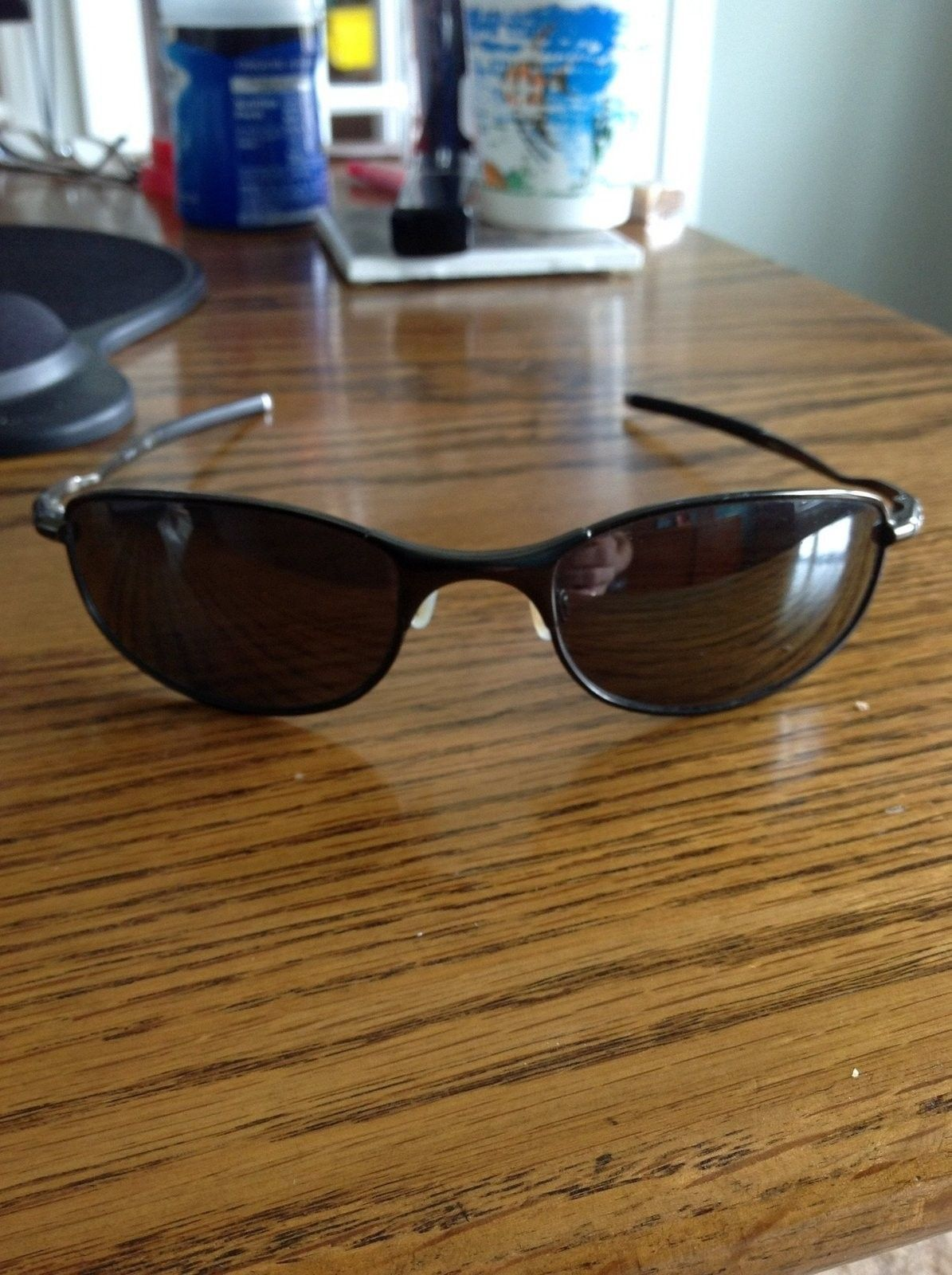 Need help identifying model of oakley sunglasses - image.jpg