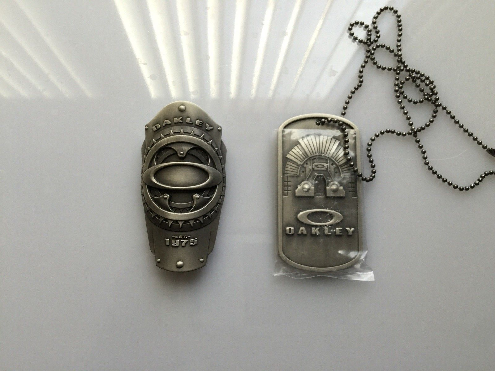 Oakley metal works sheriff badge and big dog tag - image.jpg