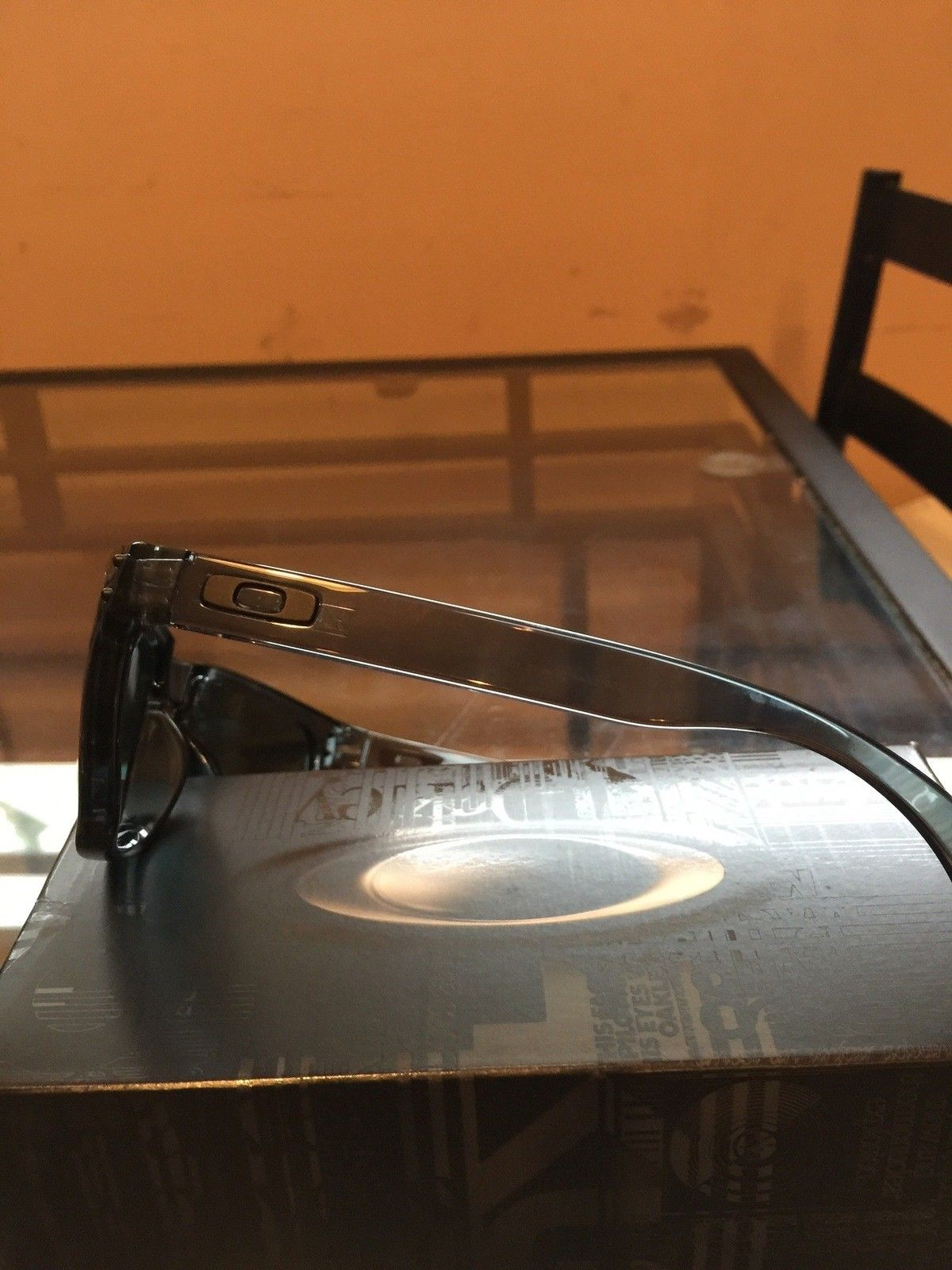 "Several items: Holbrooks, Frogskins, ""project Scar"", Four, Mag Four S Plasma, X-Metal Stand - IMG_7032.jpg"