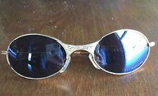 Oakley  T Wire Titanium, Gold frame Sunglasses - s-l225.jpg