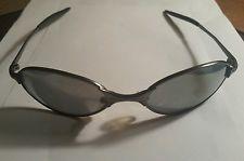 Oakley Vintage Sunglasses Silver / Black Iridium - s-l225.jpg